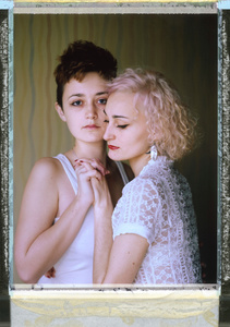 """Where love is illegal. """"O"""" (right) and """"D"""" (left), St Petersburg, Russia. Nov. 9, 2014. Lesbian couple O (27) and D (23) were holding hands and sharing a kiss on their way home after a jazz concert late at night on Oct. 19 when they say they were attacked. A stranger accused them of being lesbians, punching and kicking them repeatedly."""