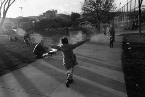 A child, her arms outstretched, runs to her mother in a park near Fener Docks.