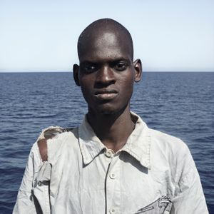 Mediterranean Sea, 1 August 2016. Abdoulie (18), from Guinea, poses for a portrait minutes after being rescued on the Mediterranean Sea, 20 nautical miles off the Libyan coast by a rescue vessel provided by the NGO Jugend Rettet. The rubber boat in which he travelled carried 118 people on board, who were transferred by the Italian Coast Guard to Lampedusa (Italy).