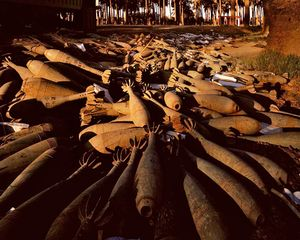 "Abandoned mortar shells in a date grove in Atifya, northern Baghdad. Baghdad 19-27 April 2003. From ""Forensic Traces of War"" © Simon Norfolk"