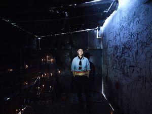 Teenager devotee of Gauchito Gil in the praying room of temple of the popular saint in El Campito de la Carolina