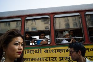 A hijra walks past a bus load of curious on-lookers during Mumbai's gay pride march.  © Alison McCauley