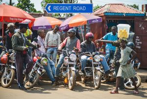 Taxi bikes wait for a fair in Freetown. Motorcycles are one of the main forms of transport in Freetown.