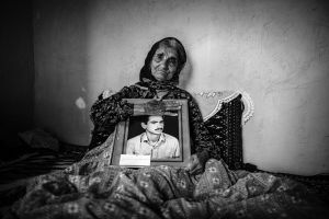 Azizeh Salari (78) is the mother of martyr Mostafa Salari (20). Her son was martyred in Kurdistan and the mother had been waiting for 26 years to hear a piece of news of Mostafa's body. Like many other mothers, Azizeh remains at home everyday and waits for a phone call so that she will hear a piece of news of her missed son _ Mazandaran