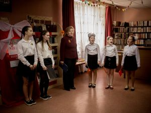 During the May 9th Victory Day every Donetsk's school celebrates; Students singing traditional Soviet songs.