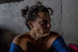 """Tijuana, Mexico, November 17th, 2014. Desiree Miranda, also known as """"Boxer"""", cries as she tells her story in the tunnel where she lives."""