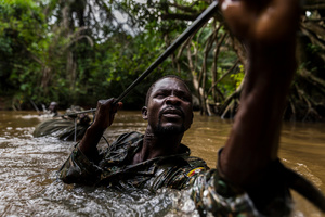 Ugandan soldiers cross a river while on patrol against the Lord's Resistance Army close to the border of the DRC. Mbeki, Central African Republic, 26 November 2014.