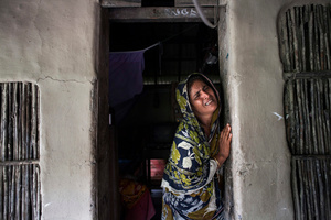 Rizia(40), her husband Mazed Gain killed by tiger attack in 2012, she has three children. Thousands of men and women go into the Sundarbans forest in Southern Bangladesh every day to gather honey, collect firewood, or catch fish, crabs and putting themselves at great risk for a tiger attack.