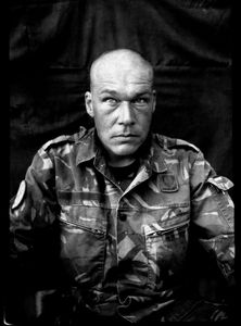 """KABUL PORTRAITS. """"Sergeant first class Andre, mortar squad leader"""". Portraits of Dutch ISAF troops in Kabul, Afghanistan. The photos are taken with the antique box camera, borrowed from an Afghan street photographer in Kabul. The exposure time of each photo was 10 seconds."""