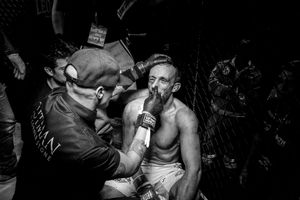 As the fight ends with a technical knockout, the Italian Marco Manara, defeated, is treated by the cutman, who monitors his condition and tampons his wounds.