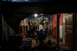 """Barber shop in the Jungle camp.Daily life of refugees at the so-called """"Jungle"""" migrant camp in the northern French city of Calais on November 5, 2015."""