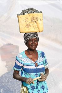 Aceng Rose: Earns 1,000 shillings ($0.32) per Jerrycan of gravel.