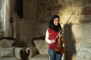 Ala Shalalda is a young musician who studies the violin at Al Kamandjâti, which first opened in 2005 and is located next to her home. Her older brother, Shehada, trained to become a violin maker in the UK. Ala practices on the very first violin her brother made daily. Ala has been studying the violin for six years and she hopes to become a professional musician. © David Brunetti