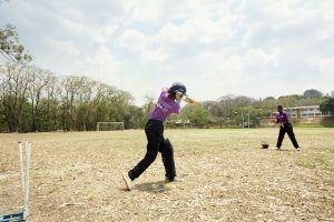 Shahida tries to catch a ball during fielding practice. Malawian Under 19 Women's Cricket Team, Blantyre, Malawi, 2016.
