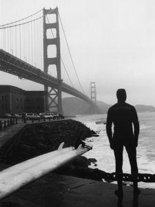 Preparing to ride the waves under Golden Gate bridge in San Francisco