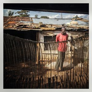 A man stands outside a house in Kibera. The Kibera slum is the largest slum in Nairobi with around half a million inhabitants.