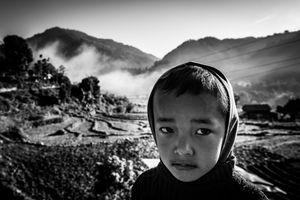 A boy against a background of the Himalayas in Baluwa, near the epicenter of the earthquake of 25 April 2015.