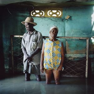© Gideon Mendel, Christa and Salomon Raymond Fils, September 2008, Decade Village, Haiti. Series: Drowning World