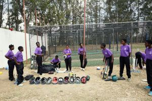 The girls pack away their kits after training. Malawian Under 19 Women's Cricket Team, Blantyre, Malawi, 2016.