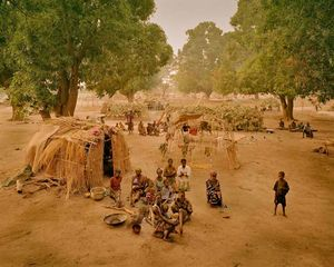 "The unorganized camp at Moro in the Province of Moyen Chari, in southern Chad, 25km north of the border with the Central African Republic. In May 2003, at this location there were 6,000 of the approximately 30,000 CAR refugees in Chad. From ""Forensic Traces of War"" © Simon Norfolk"