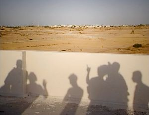 Gaza (2005). The shadows of Palestinian youths are projected on the wall of the house where they gathered to 'spy' on  the Israeli settlement of Eli Sinai, on the eve of its evacuation under the Disengagement Plan.