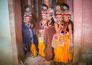 Ras dancers wait to perform the Maha Ras Lila.