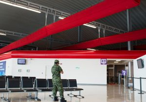 Soldier texting at Toluca Airport. In transit towards Ixtapa.