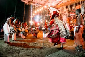 During the prelude to a night-time Theyyam the performer dances himself into a trance.