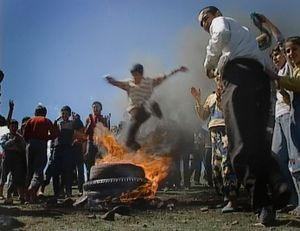 In the hills around Cizre, south-east Turkey. March 20, 2003. Newroz.  Kurdish boys jump over burning tyres. Fire means testing one's readiness to fight.
