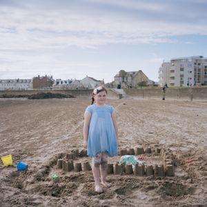 Girl building sandcastles