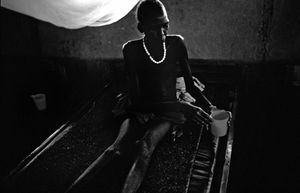 A patient holds a cup of water at the Médecins Sans Frontières  health clinic in the village of Walgak. © Tomas van Houtryve