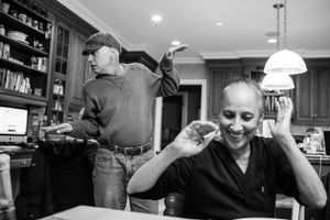 In his kitchen, Howie Borowick breaks into a bouncing dance to hopefully get a smile out of wife, Laurel. Chappaqua, New York. February, 2013 © Nancy Borowick