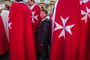 Members of maltese cross at the procession of S.Agata in Catania
