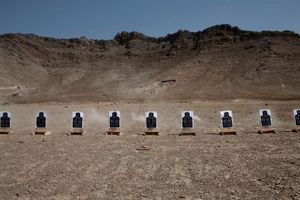 Targets sit on a shooting range during an introduction to firearms class for Afghan National Civil Order Police (ANCOP) at the Kabul Military Training Centre in Afghanistan on August 22 2011. © Adam Ferguson