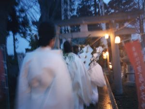 Shinto Priests are rushing to an early morning ritual on a cold winter day.© Uma Kinoshita