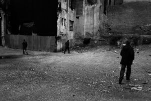 Three man in an abandoned area near the city center. Athens, Greece Enri Canaj
