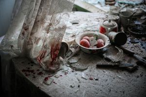 Kitchen table after mortar attack, Donetsk, Ukraine, 26 August. General News Singles, 1st place. Sergei Ilnitsky, Russia, European Pressphoto Agency