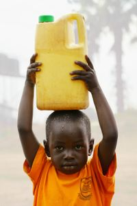 Gregory:  Carrying a 1.5 liter container of water home, Layibi, Uganda.