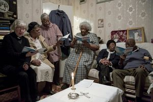 Mrs Littles home communion Old age and poor health mean Mrs Little is no longer able to attend the church of St. Andrews on Soho Road. An Anglican priest celebrates communion in Mrs Little's front room every week with her friends from the church.  © Liz Hingley