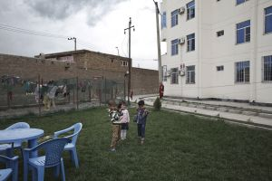 Kids play in Shahrak-e Arya, a new district of apartment complexes in the north of Kabul, near the airport | Kabul, Afghanistan 2013 © Sandra Calligaro
