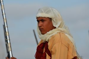 Young fantasia (Tbourida) rider  contemplates the forthcoming charge. Oued Merzeg, Morocco