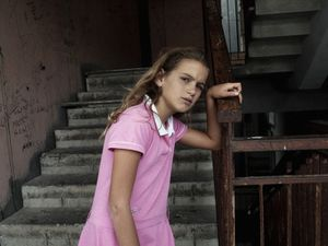 La Vela Rossa (The Red Sail), 9th floor, Scampia, Naples.  Anna, nine years old. © Valerio Spada.