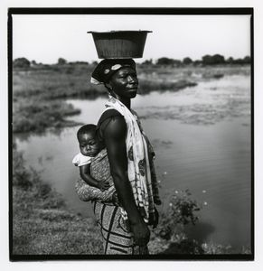 woman and child at guinea worm infested pond