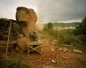 UNRECOGNIZED REPUBLIC OF NAGORNO-KARABAKH / Stepanakert / 7.09.2011. An assistant to the sculptor Robert Askarian is working on a stone with the grinding machine forming a sculpture which has been commissioned for the Memorial Complex which also belongs to the War Cemetery.
