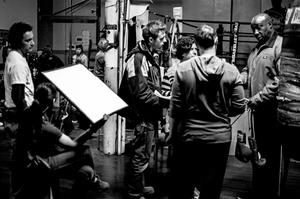 Cast & crew discuss a scene.