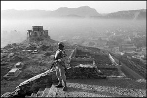 An American GI on a dawn patrol over the hill overlooking the capital. Kabul, Afghanistan. © ABBAS / MAGNUM PHOTOS