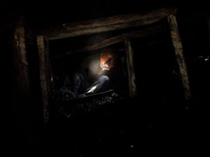 Coal miner in an illegal coal mine during work.