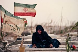 Bam, Iran: The woman mourns on the grave of her family that died in the cataclysmic 2003 earthquake. The earthquake flattened most of the town, including the legendary citadel. © Matjaz Krivic
