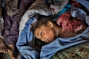 A girl lies dead in a makeshift morgue, part of a field hospital in the Shaar district of Aleppo on February 10, 2013. © Nish Nalbandian