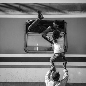 Hundreds of refugees pour onto trains in Tovarnik, Croatia.